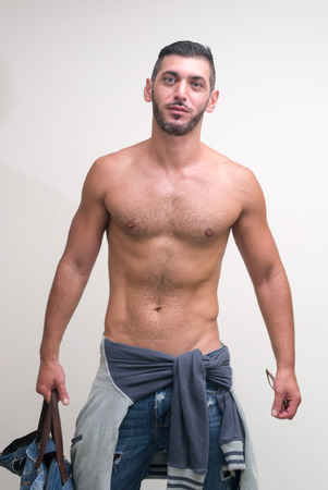 partially nude: Portrait of handsome man Stock Photo