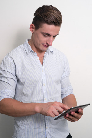 one mid adult man only: Man using digital tablet