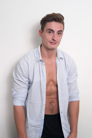 sixpack: Handsome man standing with shirt open