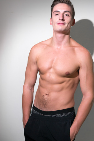 partially nude: Shirtless handsome bodybuilder