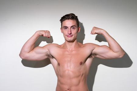 partially nude: Man flexing his biceps
