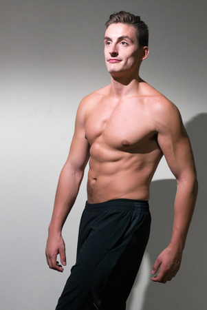 partially nude: Portrait of handsome bodybuilder Stock Photo