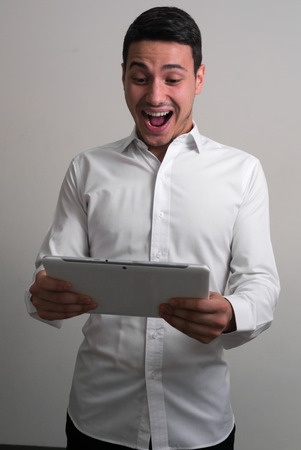 only one mid adult male: Businessman using digital tablet