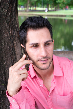 telephoning: Handsome businessman talking on the phone outdoors Stock Photo