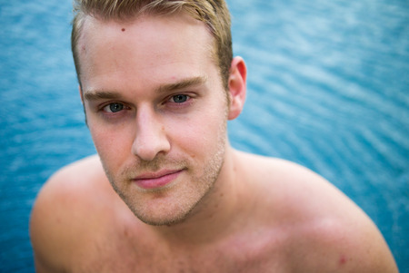 partially nude: Young Handsome Man Swimming