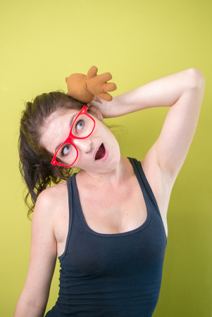 only mid adult women: Sexy woman wearing red glasses and holding toy in her hand Stock Photo