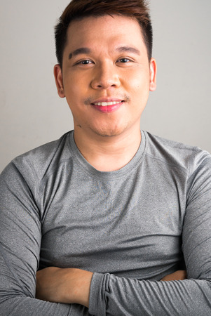 filipino ethnicity: Portrait of young Filipino man vertical studio shot