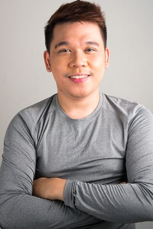 one mid adult man only: Portrait of young Filipino man vertical studio shot