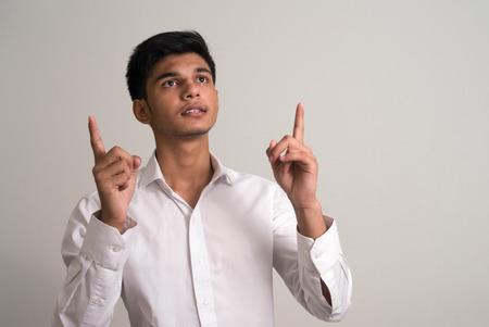 and the horizontal man: Young Indian man Horizontal studio shot