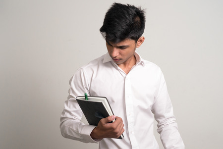 man holding book: Young man holding book Stock Photo