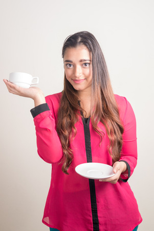 one mid adult woman only: Beautiful Indian woman holding coffee cup