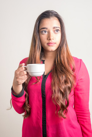 only mid adult women: Beautiful Indian woman holding coffee cup