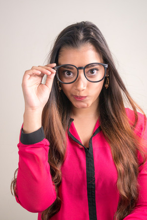 indian subcontinent ethnicity: Vertical studio shot of beautiful Indian woman wearing glasses