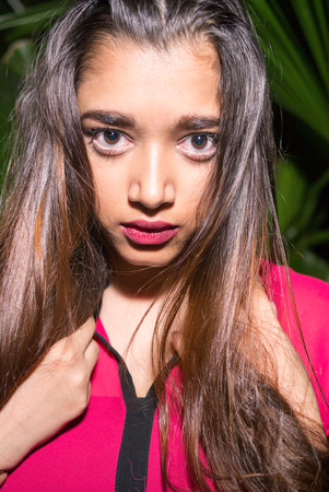 only mid adult women: Portrait of beautiful Indian woman outdoors at night