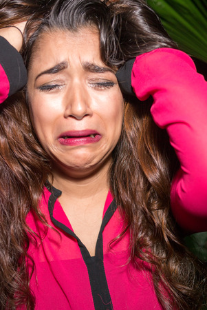 dissapointed: Beautiful woman crying outdoors at night Stock Photo