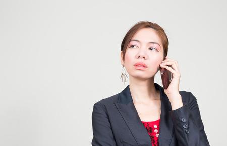 southeast asian ethnicity: Asian businesswoman using phone