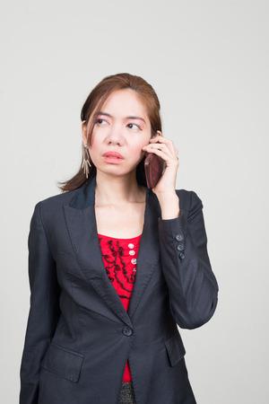 southeast asian ethnicity: Portrait of Asian businesswoman using phone