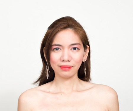 partially nude: Topless Asian woman