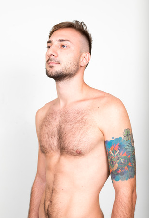 partially nude: Nude man with tattoos