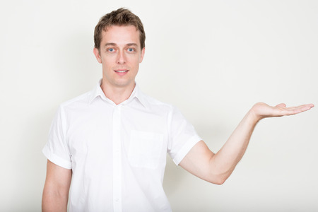 only one mid adult man: Handsome man offering copy space to use Stock Photo