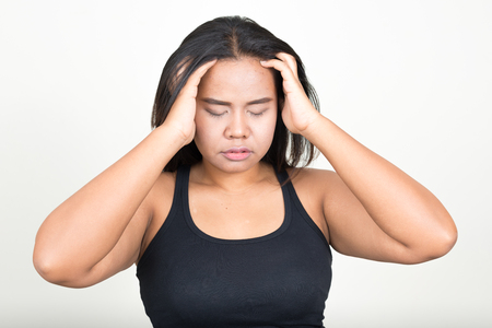 dissapointed: Overweight woman having headache