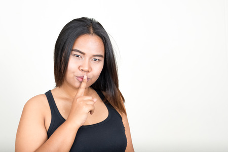 shh: Overweight woman making shh gesture Stock Photo