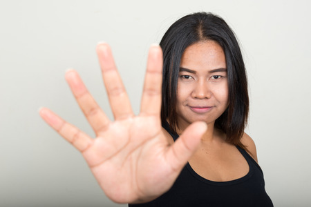 woman stop: Overweight woman making stop gesture