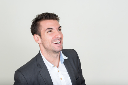 spanish looking: Portrait of handsome businessman laughing