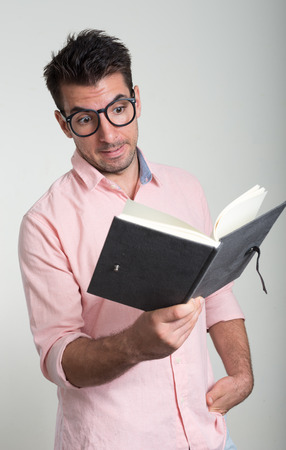 going crazy: Business man going crazy while holding book Stock Photo