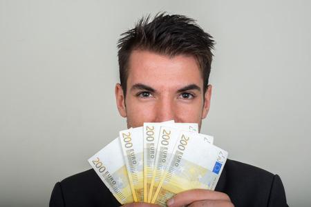 one hundred euro banknote: Man holding 200 euro bills