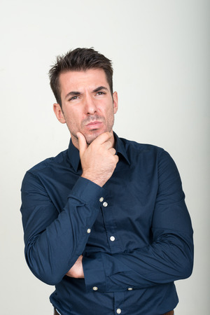 one mid adult man only: Portrait of handsome man thinking Stock Photo
