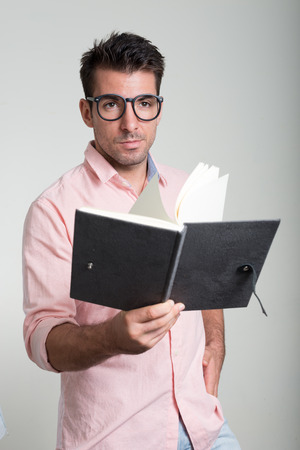 man holding book: Handsome man holding book