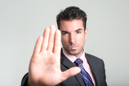 stop: Business man telling to stop