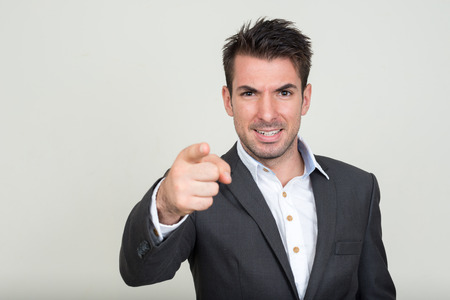 southern european descent: Businessman pointing to camera