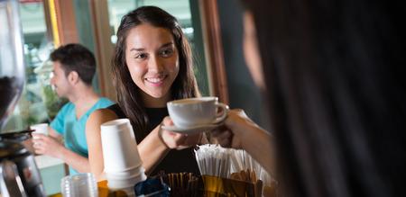 ordering: Woman ordering coffee