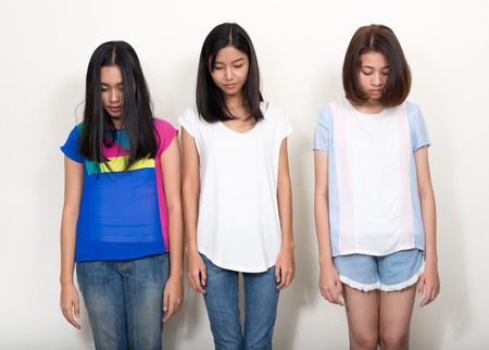 asian adult: Portrait of three teenager girls standing