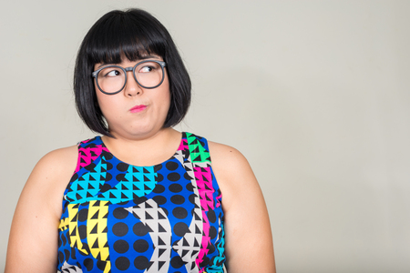woman think: Fat Asian woman wearing eyeglasses