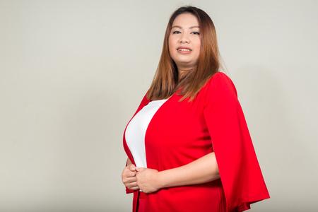 obesidad: Mujer gorda sonriendo Foto de archivo