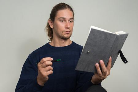 man holding book: Man holding book