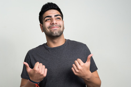 only young adults: Man giving thumbs up