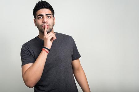 shhh: Man holding finger on lips