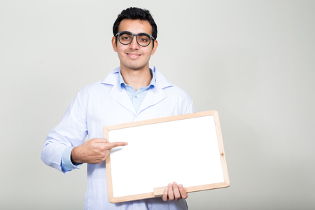 empty of people: Doctor holding empty whiteboard