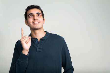 pointing finger up: Indian man pointing finger up