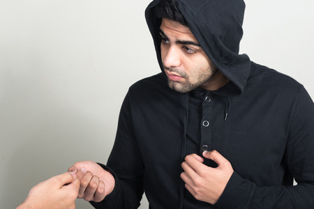 abusive man: Criminal doing illegal transaction Stock Photo