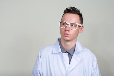 laboratory coat: Portrait of male scientist wearing white nerdy glasses