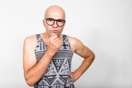hombre calvo: Man wearing nerd glasses thinking Foto de archivo