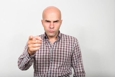 man head: Portrait of bald businessman pointing finger at you Stock Photo