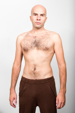 topless: Shirtless bald man