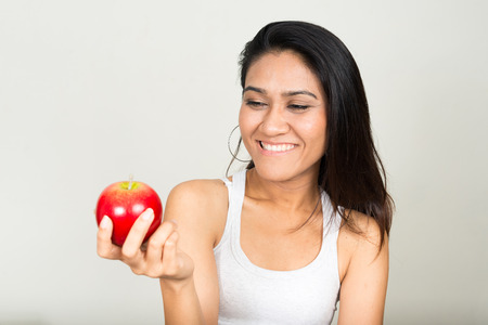 sexy asian woman: Portrait of Asian woman holding apple and smiling