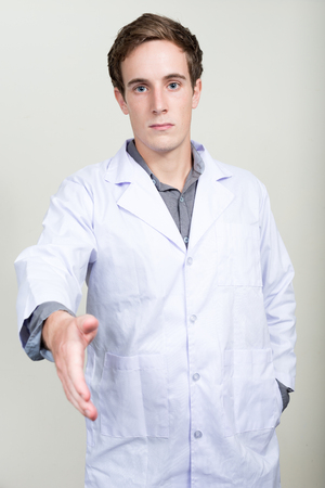 medical professional: Doctor offering hand shake Stock Photo